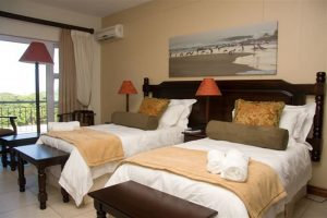 Twin beds in room at Umthunzi Hotel