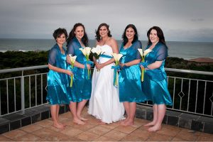 Weddings @ Umthunzi -- Bride and Bridesmaids on balcony