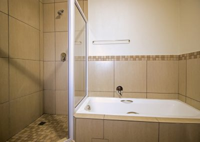 Deluxe room Bathroom with shower and bath