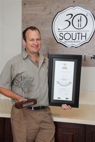 Ryan proudly showing off Lilizela Award for best 3 star hotel 2014