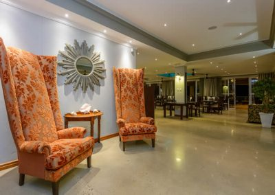 Umthunzi Hotel  entrance chairs night shot towards restaurant
